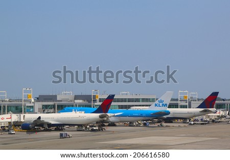 NEW YORK- JULY 22:  KLM Boeing 747, Delta Airline Boeing 747 and Airbus A330 at the gates at the Terminal 4 at John F Kennedy International Airport in New York on July 22, 2014 - stock photo