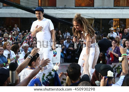NEW YORK-JULY 11: Lin-Manuel Miranda (L) and Jennifer Lopez perform onstage at NBC's Today Show at Rockefeller Plaza on July 11, 2016 in New York City. - stock photo