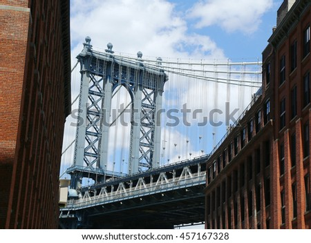 NEW YORK - JULY 21, 2016: Manhattan Bridge view. The Manhattan Bridge is a suspension bridge that crosses the East River, it was opened on December 31, 1909 and was designed by Leon Moisseiff