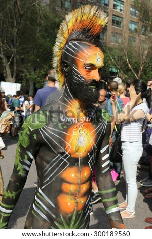 NEW YORK - JULY 18, 2015:Model during second NYC Body Painting Day in midtown Manhattan featuring artist Andy Golub in New York.Artists paint 100 fully nude models of all shapes and sizes during event - stock photo