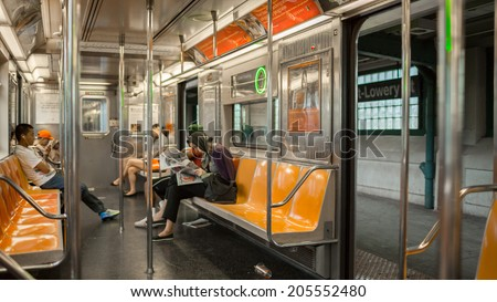 NEW YORK - JULY 14, 2014: MTA elevated subway train station in New York. The NYC Subway is a rapid transit/transportation system in the City of NY. - stock photo