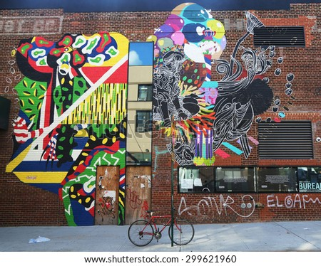 NEW YORK - JULY 23, 2015: Mural art at East Williamsburg in Brooklyn.Outdoor art gallery known as the Bushwick Collective has most diverse collection of street art in Brooklyn - stock photo