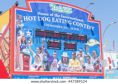 NEW YORK, JULY 4, 2016 - Nathan's hot dog eating contest countdown clock and 100th birthday of Nathan's Famous restaurant at the corner of Surf and Stillwell avenues, Coney Island - stock photo
