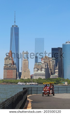 NEW YORK - JULY 6: Riders on quadcycle at the  Governors Island on July 6, 2014. Governors Island is a 172-acre (70 ha) island in Upper New York Bay