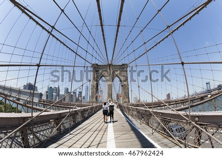 NEW YORK - 20 JULY 2016: The Brooklyn bridge 20 July 2016 in New York City. The Brooklyn Bridge is one of the oldest suspension bridges in the United States.