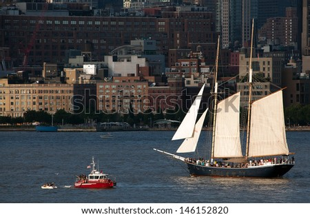 NEW YORK - JULY 4: The Clipper City Tall Ship sailing on the Hudson River on July 4th, 2013. The original 1854 Clipper City schooner was decommissioned in 1890, but rebuilt in 1984. - stock photo