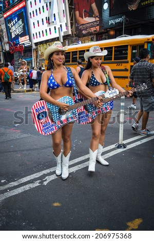 NEW YORK-JULY 23: the Naked Cowgirls in Times Square on a hot humid day on July 23 2014 in Manhattan. - stock photo