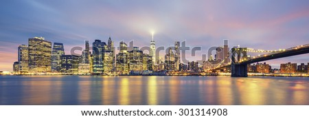 NEW YORK - JULY 2015: View of New York City Manhattan skyline on July 7, 2015. Manhattan is the central part of New York. It is one of the leading cultural and economic centers in the world. - stock photo