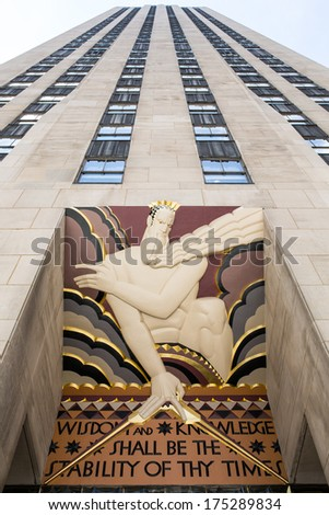 NEW YORK - JULY 06: Wisdom, an art deco piece by Lee Lawrie over the entrance of 30 Rockefeller plaza on July 06, 2013, in New York, NY - stock photo