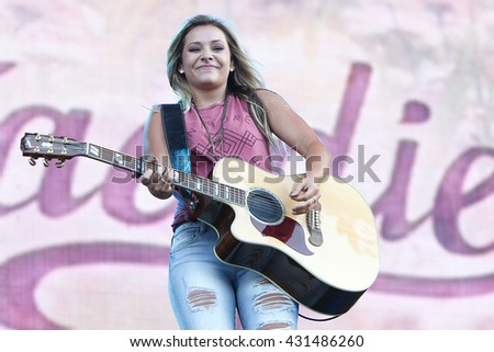 NEW YORK-JUN 26: Country musicians Taylor Dye of Maddie & Tae performs onstage at the 2015 FarmBorough Festival - Day 1 at Randall's Island on June 26, 2015 in New York City. - stock photo