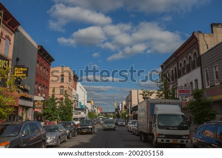 NEW YORK - JUNE 15: A Bushwick street on June 15th, 2014 in Bushwick, Brooklyn. Bushwick is bound by Williamsburg to the north and Ridgewood, Queens to the northeast.  - stock photo