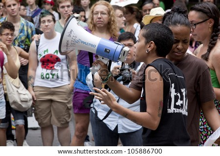 NEW YORK - JUNE 22: A member of FIERCE speaks to an audience of supporters in Washington Square Park during the 8th Annual Trans Day of Action on June 22, 2012 in New York City. - stock photo