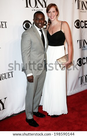 NEW YORK-JUNE 8: Actor Joshua Henry (L) and Cathryn Stringer attend American Theatre Wing's 68th Annual Tony Awards at Radio City Music Hall on June 8, 2014 in New York City. - stock photo