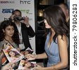 NEW YORK - JUNE 23: Actress Selena Gomez signes autographs to fans at the 'Monte Carlo' screening at AMC Loews Lincoln Square on June 23, 2011 in New York City. - stock photo