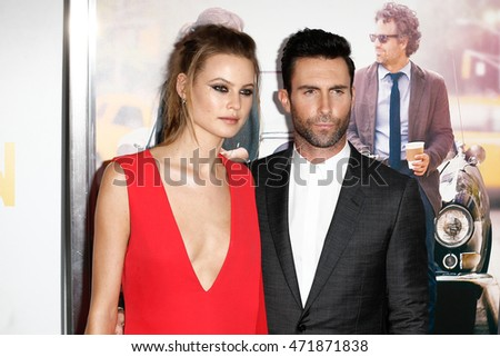 "NEW YORK-JUNE 25: Behati Prinsloo (L) and Adam Levine attend the New York premiere of ""Begin Again"", sponsored by Delta Airlines and Budweiser at the SVA Theater on June 25, 2014 in New York City."