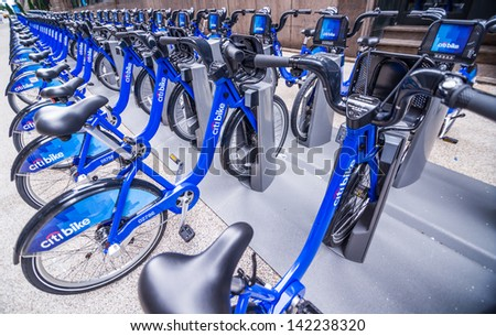 NEW YORK - JUNE 14: Citi Bike docking station on June 14, 2013 in New York. Citi Bike is a privately owned for-profit public bicycle sharing system that serves New York City. - stock photo
