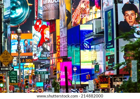 NEW YORK - JUNE 23:  Collage of neon lights, street signs and advertisements at Times Square in New York City on June 23, 2013.  Times Square holds the annual New Year's Eve ball drop. - stock photo