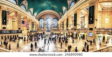 NEW YORK, JUNE 14: Commuters and tourists in the grand central station in June 14, 2013 in New York, panoramic view. It is the largest train station in the world by number of platforms: 44 - stock photo