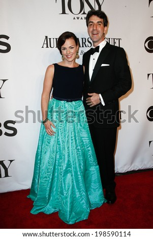 NEW YORK-JUNE 8: Composer Georgia Stitt (L) and husband Jason Robert Brown attend American Theatre Wing's 68th Annual Tony Awards at Radio City Music Hall on June 8, 2014 in New York City. - stock photo