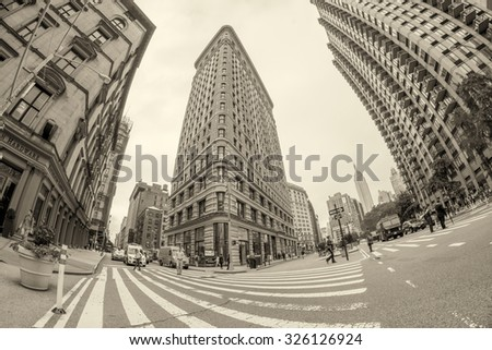 NEW YORK - JUNE 13 : Flat Iron building facade on June 13, 2013. Completed in 1902, it is considered to be one of the first skyscrapers ever built. - stock photo