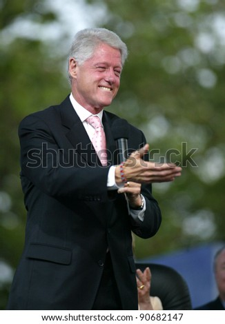 NEW YORK - JUNE 25:  Former U.S. President Bill Clinton gestures while on stage at the Greater New York Billy Graham Crusade on June 25, 2005 in Flushing, New York. - stock photo