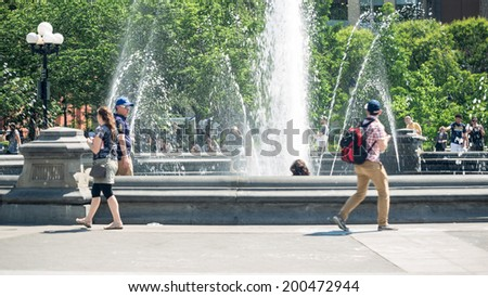 NEW YORK - JUNE 16: fountain in Washington Square Park. Washington Square Park is one of the best-known of New York City's 1,900 public parks. - stock photo