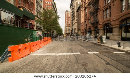 NEW YORK - JUNE 22: Greenwich Village on June 22, 2014 in New York. Greenwich Village is a largely residential neighborhood in Lower Manhattan. - stock photo