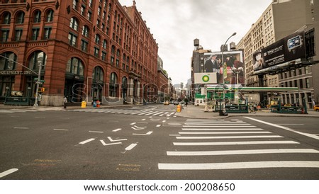 NEW YORK - JUNE 22: Houston Street on June 22, 2014 in New York. Houston Street is a major east-west thoroughfare in downtown Manhattan, running crosstown across the full width of the island. - stock photo