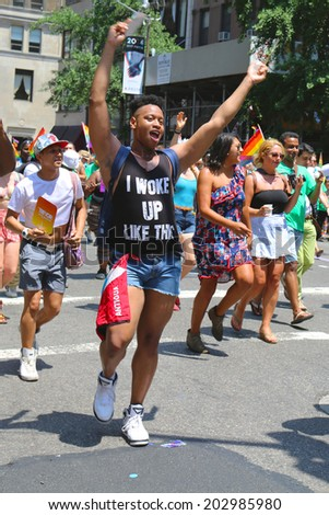 NEW YORK - June 29, 2014: LGBT Pride Parade participants in New York City on June 29, 2014. LGBT pride march takes place during pride week and is the culmination of week long festivities