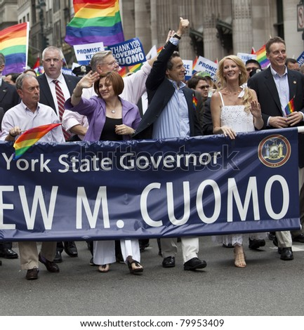 NEW YORK - JUNE 26: Mayor Michael Bloomberg, New York Governor Andrew Cuomo, Sandra Lee, City Council speaker Christine Quinn march at pride parade on Fifth Avenue on June 26, 2011 in New York City - stock photo