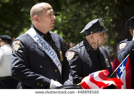 NEW YORK - JUNE 12 2016: Members of the New York Corrections Department march in the 59th annual National Puerto Rican Day Parade on 5th Avenue in New York City on June 12 2016.