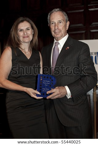 NEW YORK - JUNE 17: Michael Bloomberg, Christyne Nicholas attend Inside Broadway 2010 Beacon Awards at Players Club on June 17, 2010 in New York City. - stock photo