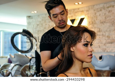NEW YORK - June 13: Model Kalyn Hemphill getting ready with hair and makeup at the Irina Shabayeva SS 2016 Bridal collection photoshoot on June 13, 2015 in New York, USA - stock photo