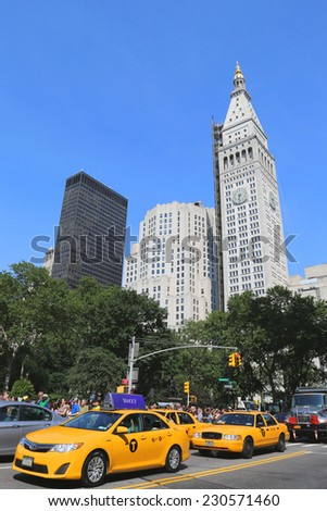 NEW YORK - JUNE 29: New York City taxis in the front of Met Life Tower at Madison Square in Manhattan on June 29, 2014 - stock photo