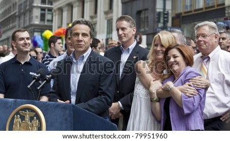 NEW YORK - JUNE 26: New York Governor Andrew Cuomo, Sandra Lee, City Council speaker Christine Quinn, New York State Senator Tom Duane attend press conference at pride parade on Jun 26, 2011 in NYC - stock photo