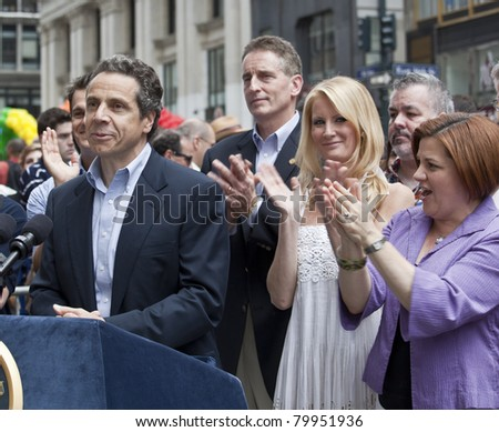 NEW YORK - JUNE 26: New York Governor Andrew Cuomo, Sandra Lee, New York City Council speaker Christine Quinn attend press conference at pride parade on June 26, 2011 in New York City, NY. - stock photo