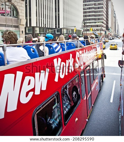 NEW YORK - JUNE 28: New York Sightseeing tour bus on June 28, 2014 in New York.  - stock photo
