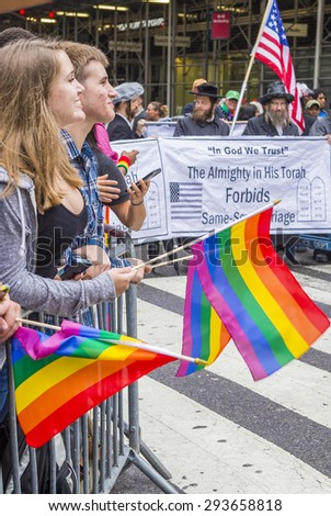 NEW YORK -  JUNE 28 : Orthodox Jews protest again the Gay Pride Parade on June 28, 2015 in New York The parade is held two days after the U.S. Supreme Court's decision allowing gay marriage. - stock photo