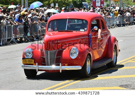 NEW YORK - JUNE 18, 2016: Participants riding car during the 34th Annual Mermaid Parade at Coney Island on June 18, 2016 in Brooklyn NY.