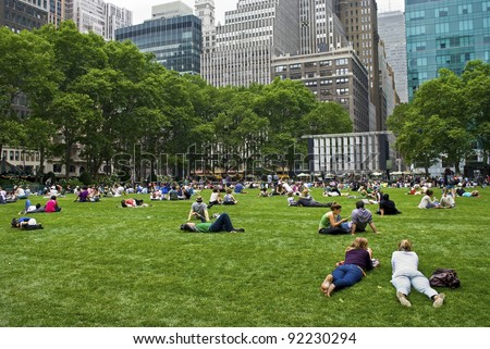 NEW YORK - June 16: People enjoying a nice day in Bryant Park on June 16, 2011 in New York City. Bryant Park is a 9,603 acre privately managed park in the center of Manhattan. - stock photo