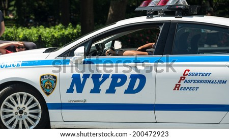 NEW YORK - JUNE 16: police car on June 16, 2014 in New York. The NYPD was established in 1845, and is the largest municipal police force in the United States