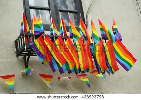 NEW YORK - JUNE 16, 2016: Rainbow flags outside the gay rights landmark Stonewall Inn  in New York City