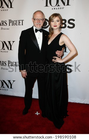 NEW YORK-JUNE 8: Robert Schenkkan (L) and guest attend American Theatre Wing's 68th Annual Tony Awards at Radio City Music Hall on June 8, 2014 in New York City. - stock photo