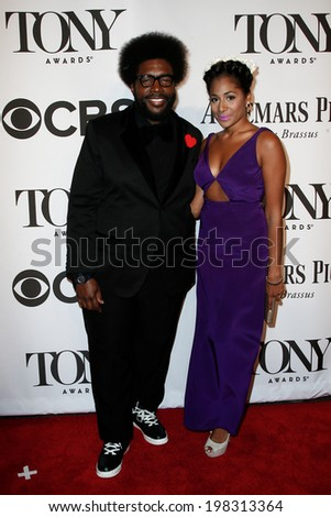 NEW YORK-JUNE 8: Roots drummer QuestLove (L) and guest attend American Theatre Wing's 68th Annual Tony Awards at Radio City Music Hall on June 8, 2014 in New York City. - stock photo