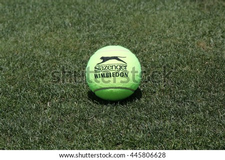 NEW YORK - JUNE 30, 2016: Slazenger Wimbledon Tennis Ball on grass tennis court. Slazenger Wimbledon Tennis Ball exclusively used and endorsed by The Championships, Wimbledon - stock photo