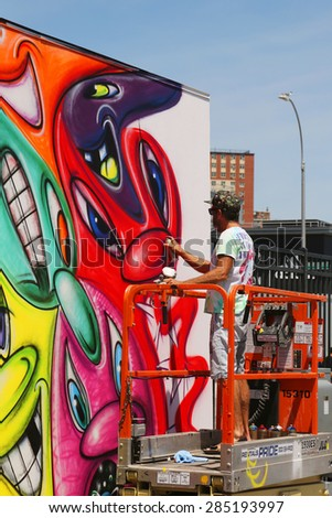 NEW YORK - JUNE 7, 2015: Street artist painting mural  at new street art attraction Coney Art Walls at Coney Island section in Brooklyn