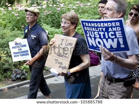 NEW YORK - JUNE 22: Supporters holding signs calling for equality and justice march through Washington Square Park on the 8th Annual Trans Day of Action on June 22, 2012 in New York City. - stock photo