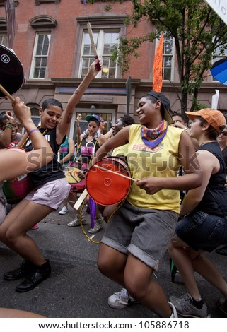 NEW YORK - JUNE 22: Supporters play homemade drums and dance outside of the LGBT Community Center during the rally on the 8th Annual Trans Day of Action on June 22, 2012 in New York City. - stock photo
