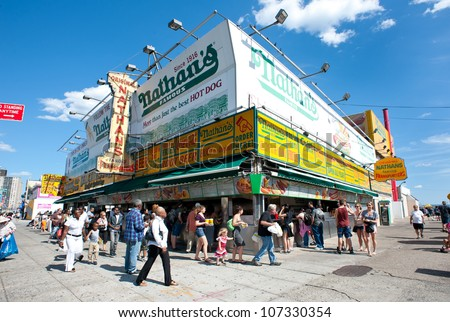 NEW YORK - JUNE 27: The Nathan's shop on June 27, 2012 in Coney Island, New York. Nathan's is a company chain of US restaurants specialized in hot dogs with 425 million Hot Dogs sold in 2011. - stock photo