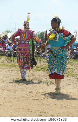 NEW YORK - JUNE 2:Unidentified female Native American dancers at the NYC Pow Wow in Brooklyn on June 2, 2013. A pow-wow is a gathering and Heritage Celebration of North America s Native people - stock photo